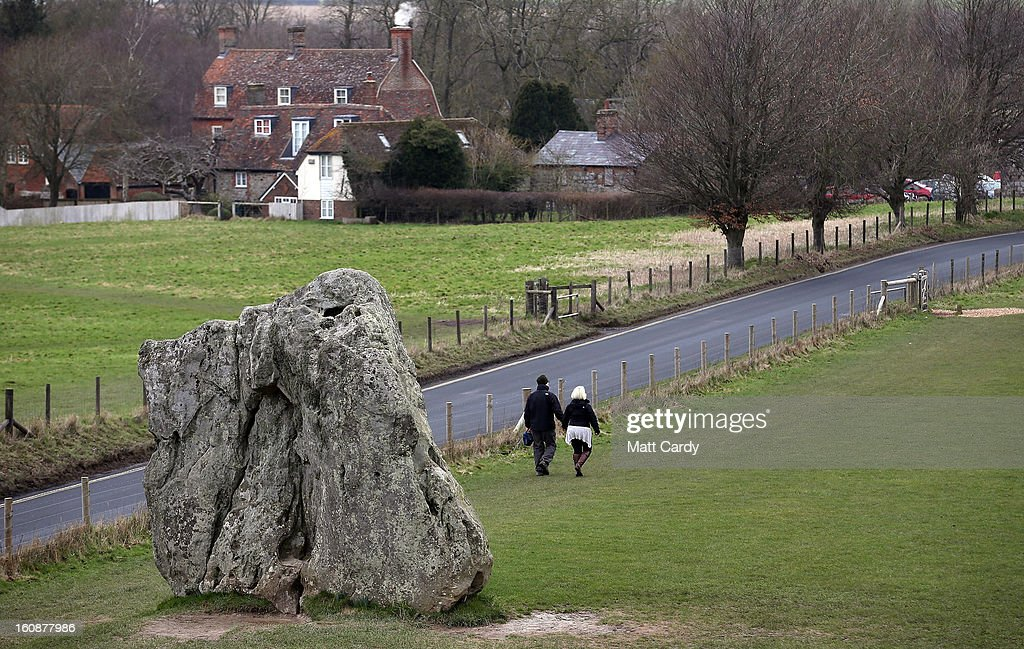Visitors walk besides the Neolithic stones at Avebury on February 7, 2013 in Wiltshire, England. A leading travel magazine has recently named the collection of stones - thought to have been constructed around 2600BC and the largest stone circle in Europe, as the second best heritage site in the world. The Wiltshire world heritage site has been placed ahead of much more recognisable sites including the Valley of the Kings in Egypt, Taj Mahal in India and the Forbidden City in China.