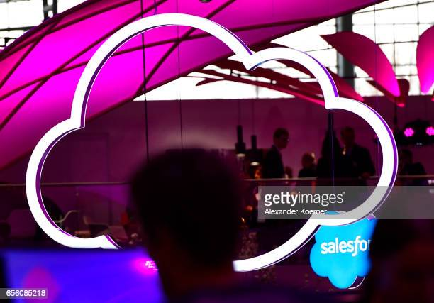 Visitors walk by a cloud sign at the Telekom stand at the CeBIT 2017 Technology Trade Fair on March 21 2017 in Hanover Germany The 2017 CeBIT will...