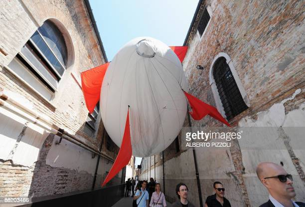 Visitors walk by an installation by Mexican artist Hector Zamora during the Venice Art Biennale on June 4 2009 at the Arsenale The 53rd International...
