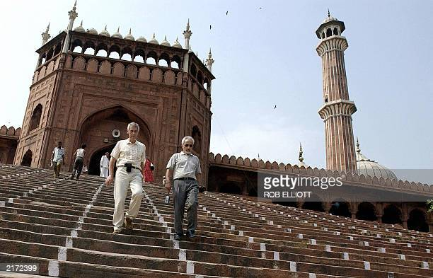 Visitors walk down the steps from the beautiful Jama Masjid or Friday mosque with its very tall and recognizable minaret in Old Delhi 04 July 2003...