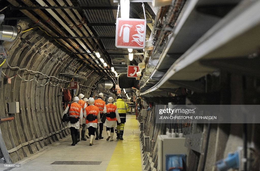 Visitors walk in a corridor at the Underground Laboratory at Bure, eastern France, operated by the French National Radioactive Waste Management Agency (Andra), on February 4, 2013.