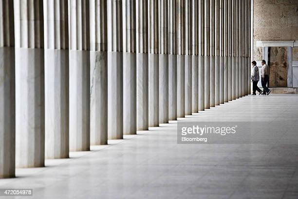 Visitors walk in the distance at the Stoa of Attalos inside the ancient Agora complex in Athens Greece on Sunday May 3 2015 Greece and its...