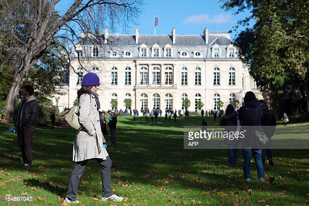 Visitors walk in the gardens of the Elysee presidential palace in Paris on October 28 2012 The Elysee gardens are now open to the public on the last...