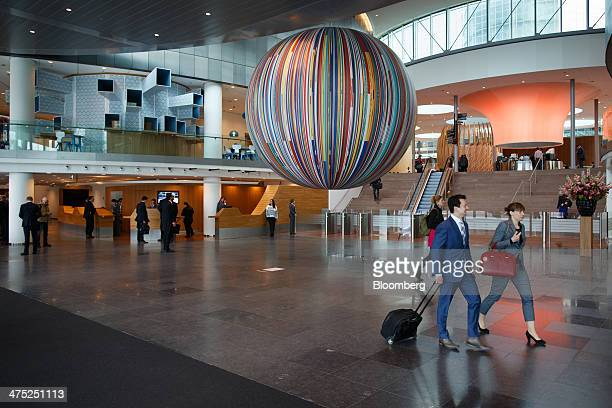 Visitors walk in the lobby of the Rabobank Groep headquarters ahead of a news conference to announce the company's fullyear earnings in Utrecht...