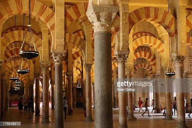 Visitors walk in the MosqueCathedral of Cordoba on July 23 2013 in Cordoba Spain Southern Spain is among the most popular tourist destinations in...