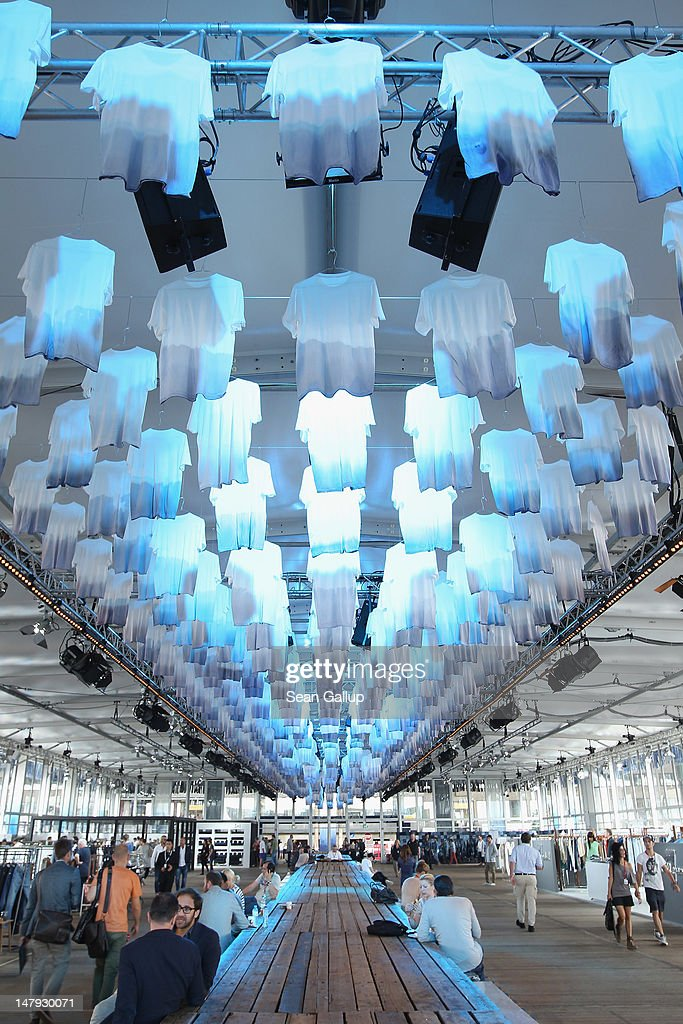 Visitors walk in the 'Tempel of Denim' hall at the 2012 Bread & Butter fashion trade fair at former Tempelhof Airport on July 6, 2012 in Berlin, Germany. Bread & Butter is the world's largest trade fair for street fashion.