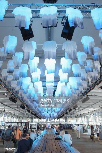 Visitors walk in the 'Tempel of Denim' hall at the 2012 Bread Butter fashion trade fair at former Tempelhof Airport on July 6 2012 in Berlin Germany...