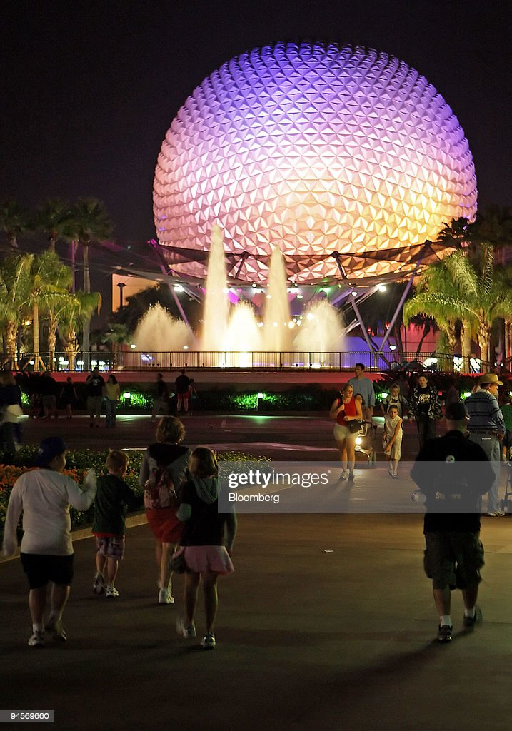 Visitors walk near Spaceship Earth at Walt Disney World's Epcot Center theme park in Orlando Florida on Tuesday Nov 13 2007 Walt Disney World has...