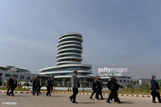Visitors walk next to the 'Iconic Tower' during the inauguration of auto giant Hero's new 'Centre of Innovation and Technology' facilities on the...