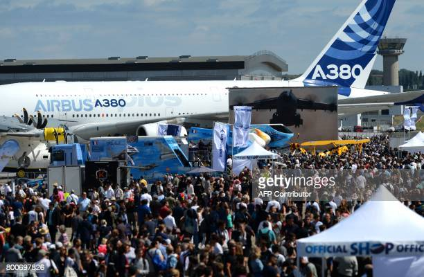 Visitors walk on the tarmac on the last day of the International Paris Air Show on June 25 2017 at Le Bourget Airport near Paris / AFP PHOTO / ERIC...