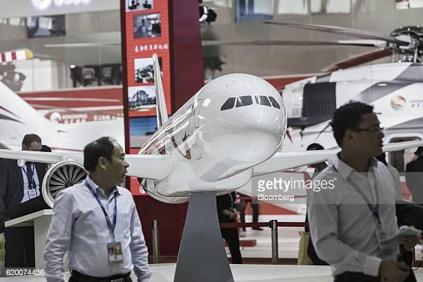 Visitors walk past a Commercial Aircraft Corp of China C919 model aircraft at the China International Aviation Aerospace Exhibition in Zhuhai China...