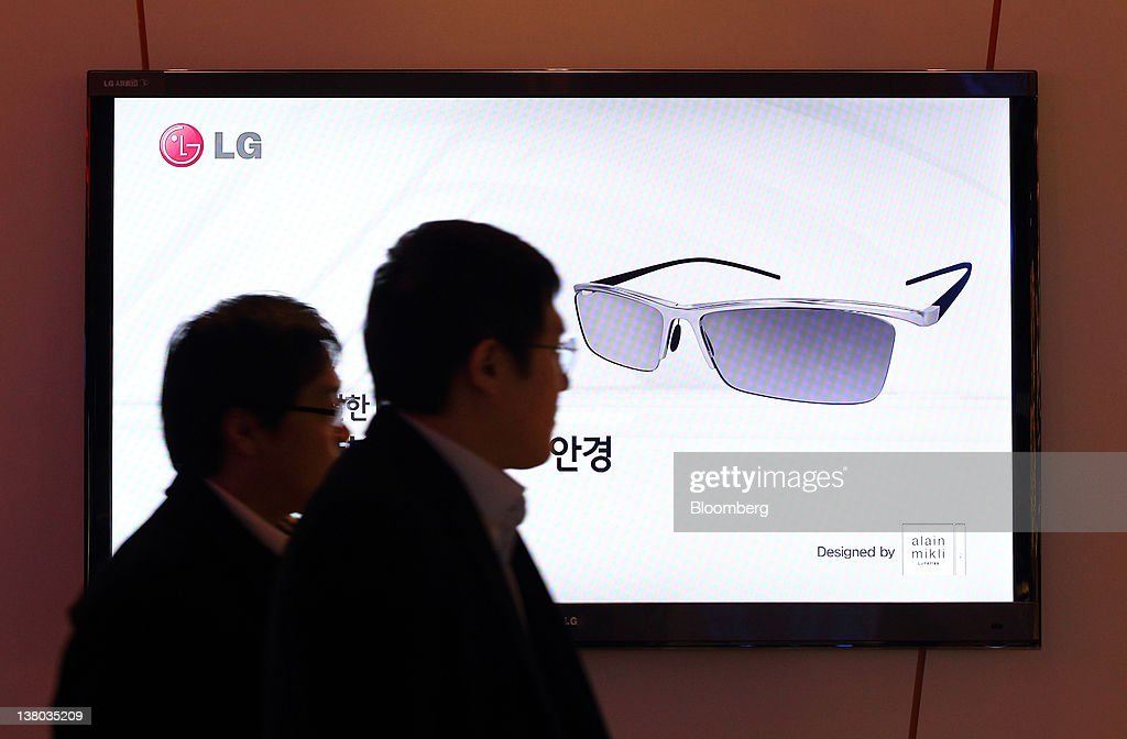 Visitors walk past a LG Electronics Inc. 3-D smart television at the company's showroom in the COEX mall in Seoul, South Korea, on Wednesday, Feb. 1, 2012. LG Electronics Inc., South Korea's second-largest electronics maker, posted the first profit at its handset business in seven quarters, helping shares reverse earlier losses in Seoul trading. Photographer: SeongJoon Cho/Bloomberg via Getty Images