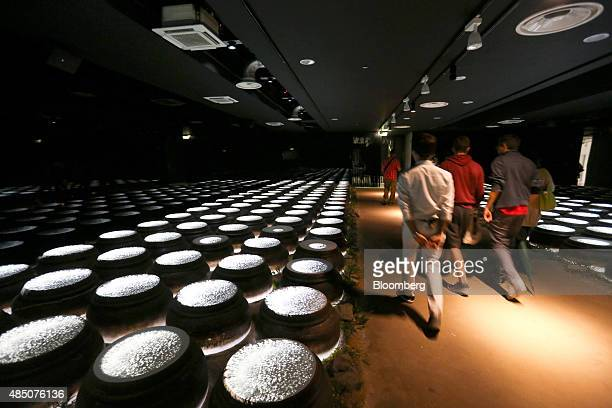 Visitors walk past a light installation inside the South Korea pavilion at the Expo 2015 exhibition in Milan Italy on Sunday Aug 23 2015 Milan won...