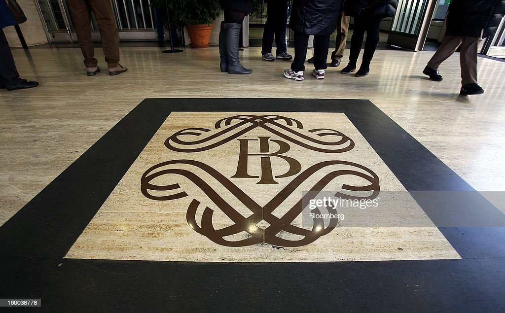 Visitors walk past a logo inside the Banca d'Italia, Italy's central bank, in Rome, Italy, on Friday, Jan. 25, 2013. Italian Prime Minister Mario Monti said the Bank of Italy will take another look at Banca Monte dei Paschi di Siena SpA's books after the company disclosed this week it may face more than 700 million euros of losses related to structured finance transactions hidden from regulators. Photographer: Alessia Pierdomenico/Bloomberg via Getty Images