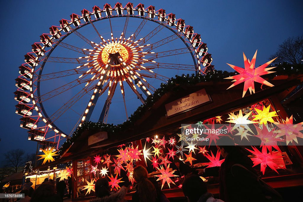 Visitors walk past a stall selling illuminated Christmas stars at the annual Christmas market at Alexanderplatz two days after the market opened on November 28, 2012 in Berlin, Germany. Christmas markets, with their stalls selling mulled wine (Gluehwein), Christmas tree decorations and other delights, are an integral part of German Christmas tradition, and many of them are opening across Germany this week.