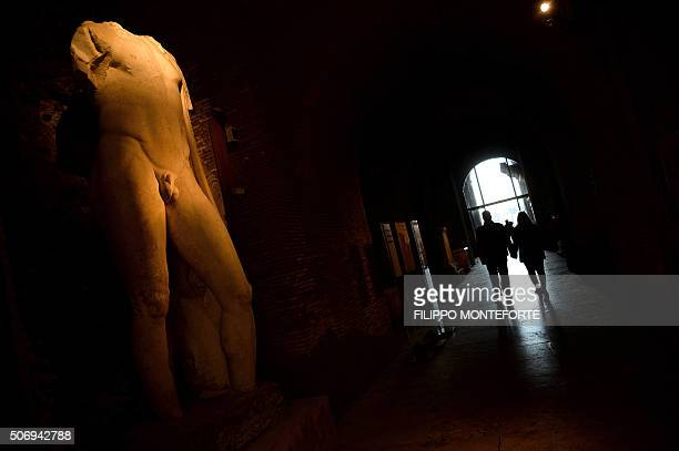 Visitors walk past an ancient marble statue on display at Rome's Capitoline Museum on Capitol Hill on January 26 2016 Italy's desire to court...