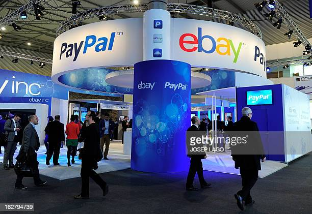 Visitors walk past an Ebay and PayPal stand at the 2013 Mobile World Congress in Barcelona on February 27 2013 The 2013 Mobile World Congress the...