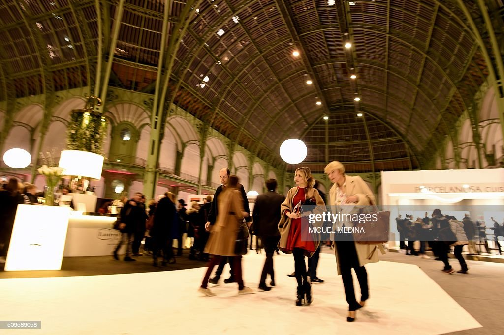 Visitors walk past during the Taste of Paris, Festival of Chefs, at the Grand Palais in Paris on February 11, 2016. / AFP / MIGUEL MEDINA