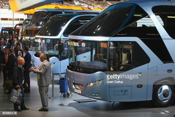 Visitors walk past MAN Neoplan buses during a media and industry professionals' day at the IAA Commercial Vehicles trade fair on September 24 2008 in...