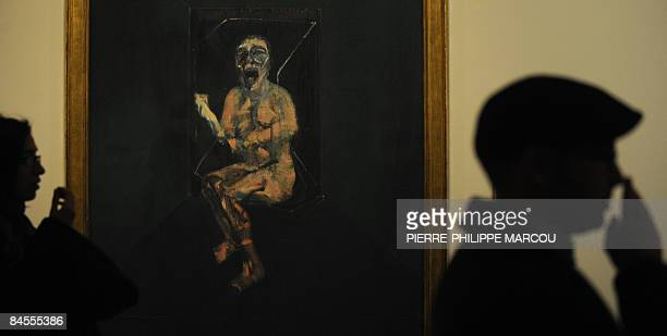 Visitors walk past next to Irish artist Francis Bacon's painting 'Study for the nurse from the battleship Potemkin' exhibited at Prado Museum in...