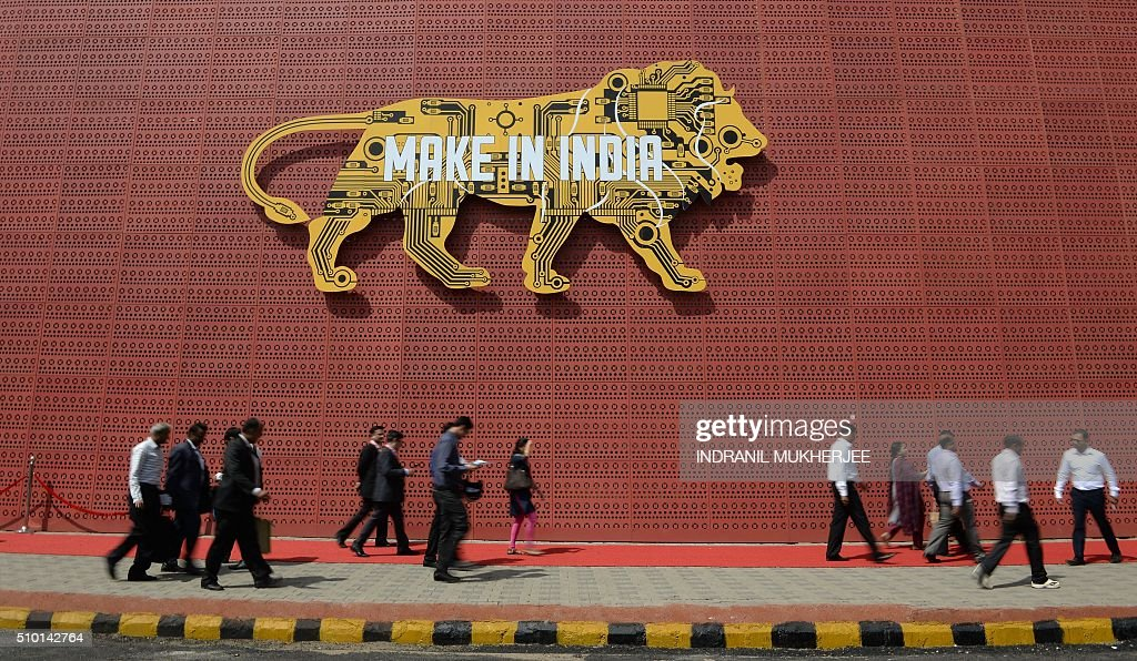 Visitors walk past one of the pavilions of the 'Make in India Week' in Mumbai on February 14, 2016. Over 190 companies, and 5,000 delegates from 60 countries, are taking part in the first 'Make in India' week held in Mumbai from February 13-18. AFP PHOTO/ INDRANIL MUKHERJEE / AFP / INDRANIL MUKHERJEE