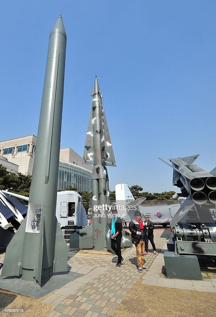 Visitors walk past replicas of a North Korean Scud-B missile (L) and a South Korean Nike missile (C) at the Korean War Memorial in Seoul on March 3, 2014. North Korea fired short-range missiles into the sea off its eastern coast for the second time in a week on March 3, prompting a warning from South Korea of 'reckless provocation.'