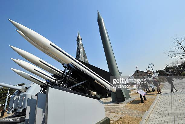 Visitors walk past replicas of a North Korean ScudB missile and South Korean Hawk surfacetoair missiles at the Korean War Memorial in Seoul on March...