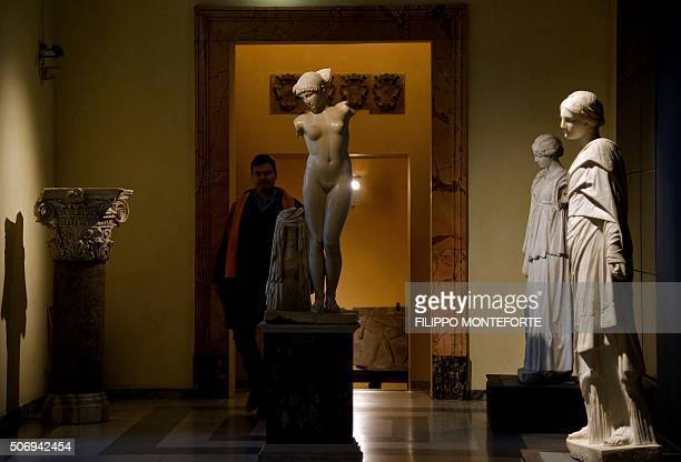 Visitors walk past statues on display at Rome's Capitoline Museum on Capitol Hill on January 26 2016 Italy's desire to court visiting Iranian...