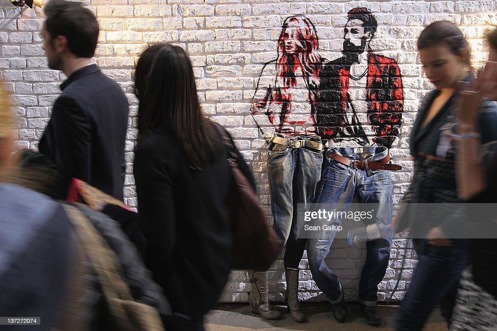 Visitors walk past street art at the Mustang stand at the 2012 Winter Bread And Butter fashion trade fair at former Tempelhof Airport on January 18, 2012 in Berlin, Germany. Bread And Butter is a semi-annual event and is among Europe's major fashion trade fairs.