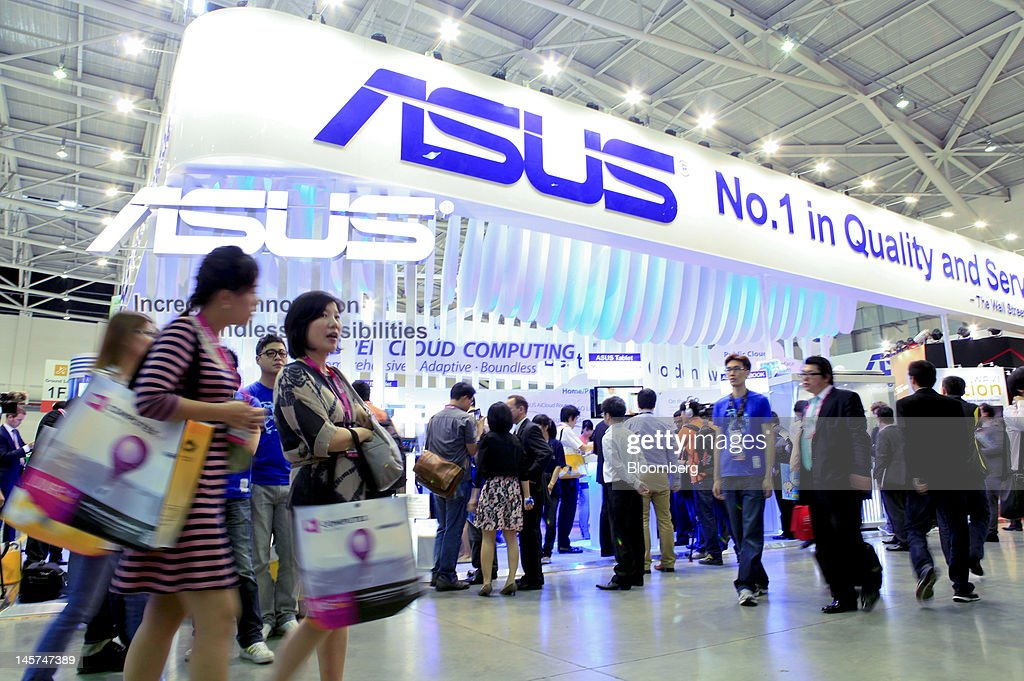 Visitors walk past the Asustek Computer Inc. booth at Computex Taipei 2012 in Taipei, Taiwan, on Tuesday, June 5, 2012. Computex Taipei 2012 takes place from June 5 to June 9. Photographer: Ashley Pon/Bloomberg via Getty Images