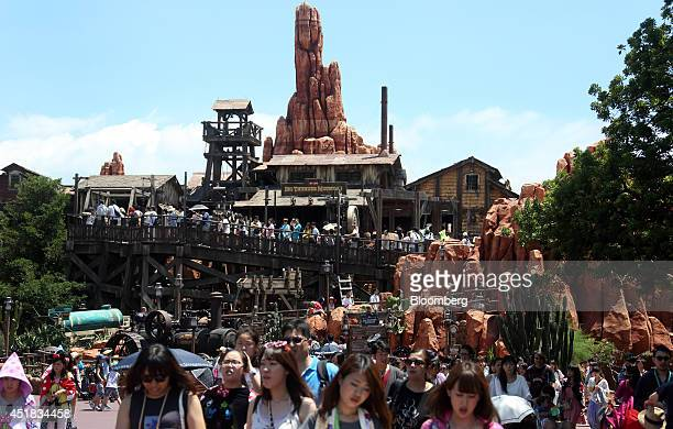 Visitors walk past the Big Thunder Mountain Railroad at Tokyo Disneyland operated by Oriental Land Co in Urayasu Chiba Prefecture Japan on Tuesday...