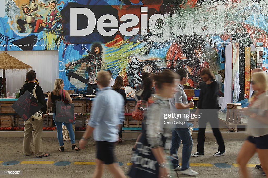 Visitors walk past the desigual stand at the 2012 Bread & Butter fashion trade fair at former Tempelhof Airport on July 6, 2012 in Berlin, Germany. Bread & Butter is the world's largest trade fair for street fashion.