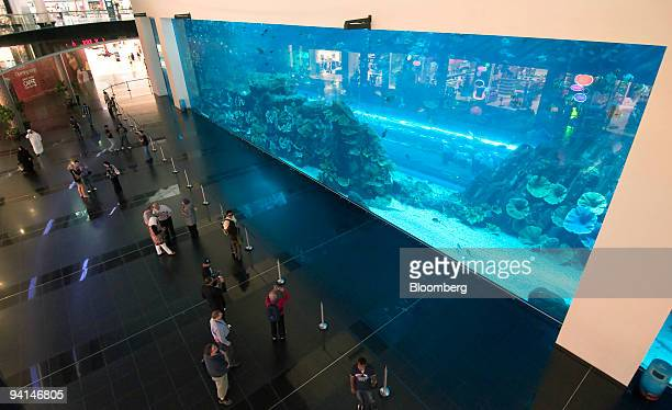 Visitors walk past the Dubai Aquarium and Underwater Zoo in the Dubai Mall owned by Emaar Properties PJSC in Dubai United Arab Emirates on Tuesday...