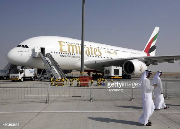 Visitors walk past the Emirates Airline Airbus A380 aircraft as it sits on static display during the 13th Dubai Airshow at Dubai World Central in...