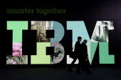 Visitors walk past the IBM logo at the CeBIT Technology Fair on March 3 2010 in Hannover Germany CeBIT will be open to the public from March 2...