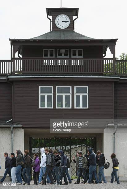Visitors walk past the main entrance on the grounds of the former Buchenwald concentration camp on June 4 2009 near Weimar Germany US President...