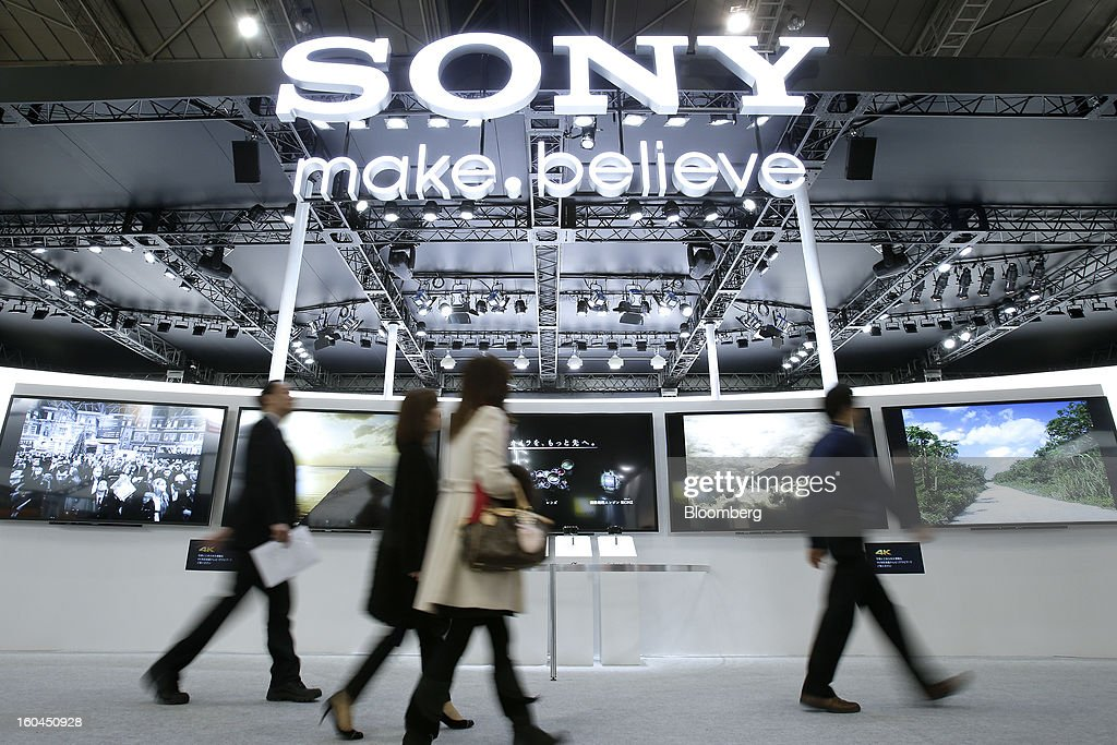 Visitors walk past the Sony Corp. booth at the CP+ Camera and Photo Imaging Show in Yokohama City, Japan, on Thursday, Jan. 31, 2013. The CP+ Camera and Photo Imaging Show runs from Jan. 31 to Feb. 3. Photographer: Kiyoshi Ota/Bloomberg via Getty Images