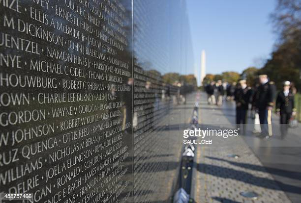 Visitors walk past the Vietnam Veterans Memorial on the National Mall in Washington DC November 10 on the eve of Veterans Day Over 58000 names of US...