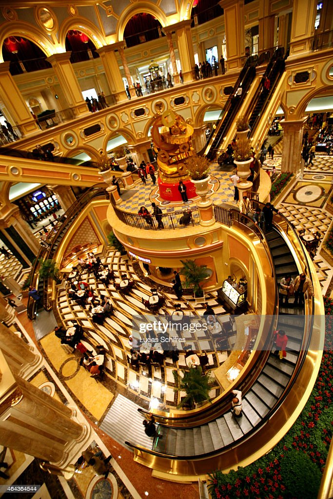 Visitors walk the main hall at the Venetian casino on February 24 2008 in Macau China The Venetian MacaoResortHotel is a 163000 square foot casino...