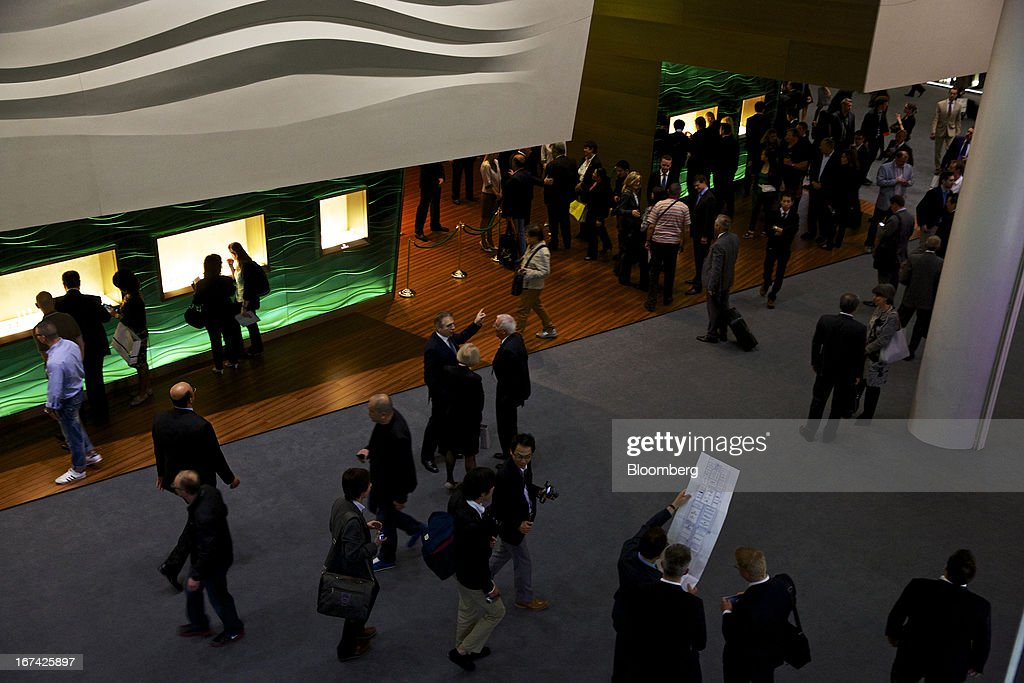 Visitors walk through a display hall during the Baselworld watch fair in Basel, Switzerland, on Thursday, April 25, 2013. The annual fair attracts 2,000 companies from the watch, jewelry and gem industries to show their new wares to more than 100,000 visitors. Photographer: Gianluca Colla/Bloomberg via Getty Images
