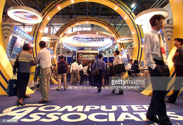 Visitors walk through an American software company's giant showroom 16 September 1999 during an international financial technology expo in Beijing...
