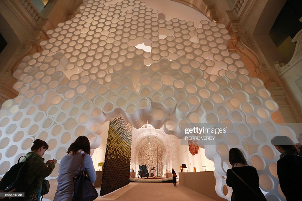 Visitors walk through an exhibition covering the work of design team Ronan & Erwan Bouroullec, formed by the two brothers from Brittany, at the Musee des Arts Decoratifs in Paris on May 16, 2013. AFP PHOTO / PIERRE VERDY