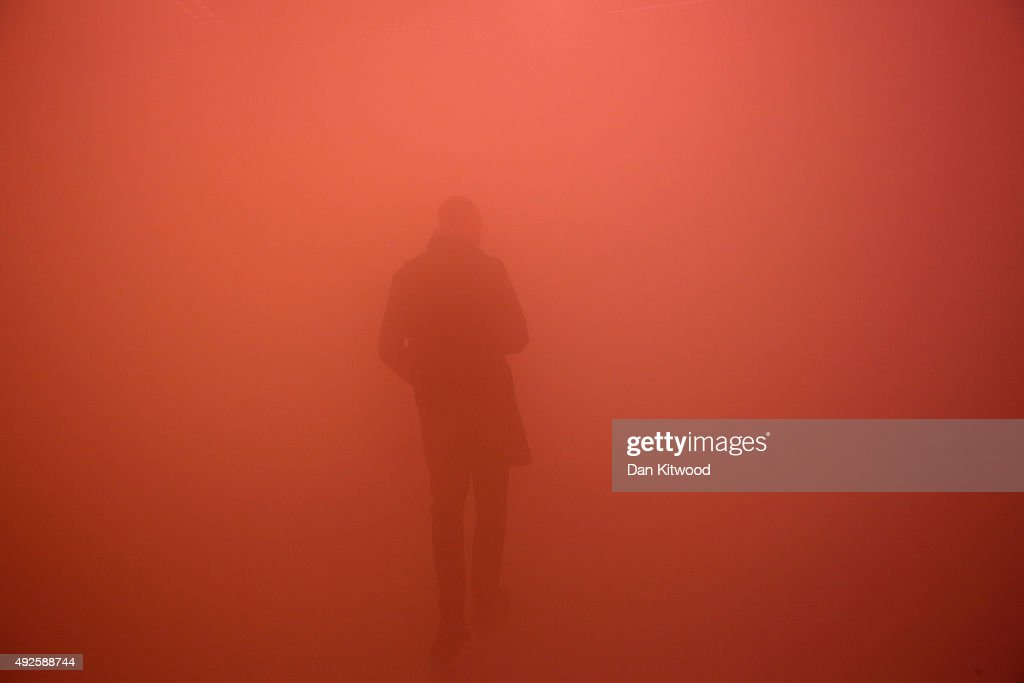 Visitors walk through an installation by artist Ann Veronica Janssens entitled 'yellowblupink' during a press preview at the Wellcome Collection on October 14, 2015 in London, England. The installation launches the Wellcome Collection's 'State of Mind' exhibition and consists of a room filled with mist coloured by different lights. The show opens to the public on October 15 and runs until January 3, 2016.