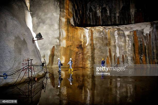 Visitors walk through cavern 5 at JTC Corp's Jurong Rock Caverns storage facility on Jurong Island in Singapore on Tuesday Sept 2 2014 The JRC is...