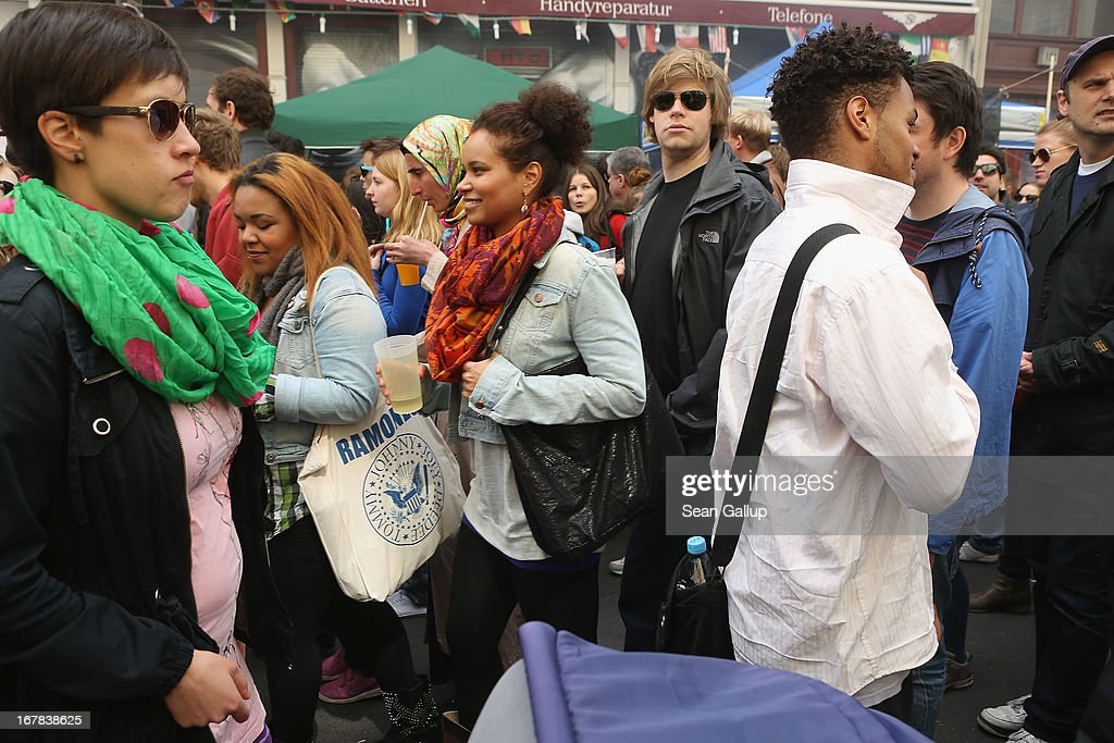 Visitors walk through crowded streets at the MyFest street food and music fest in immigrant-heavy Kreuzberg district on May Day on May 1, 2013 in Berlin, Germany. May Day, the international day of labour, is a national holiday in Germany and observed with gatherings by labour unions and political parties. In some cities, including Hamburg and Berlin, the day often ends with violent clahes between police and mostly left-wing demonstrators.