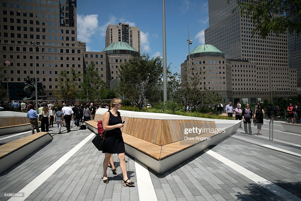 Visitors walk through Liberty Park as it opens to the public for the first time, June 29, 2016 in New York City. Liberty Park, elevated above Liberty Street in Lower Manhattan, overlooks the National September 11 Memorial Plaza and One World Trade Center. The one-acre, $50 million park will be open to the public every day from 6 in the morning to 11 at night.