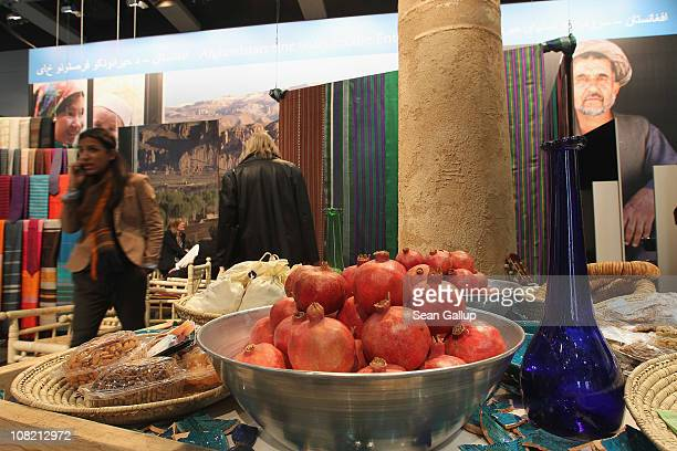 Visitors walk through the Afghanistan booth at the 2011 Gruene Woche international agricultural trade fair at Messe Berlin on January 21 2011 in...