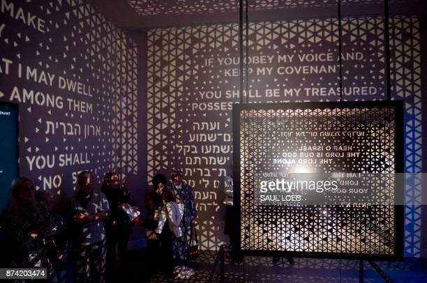 Visitors walk through the Ark of the Covenant exhibit as part of the 'Journey through the Hebrew Bible' exhibit during a media preview of the new...