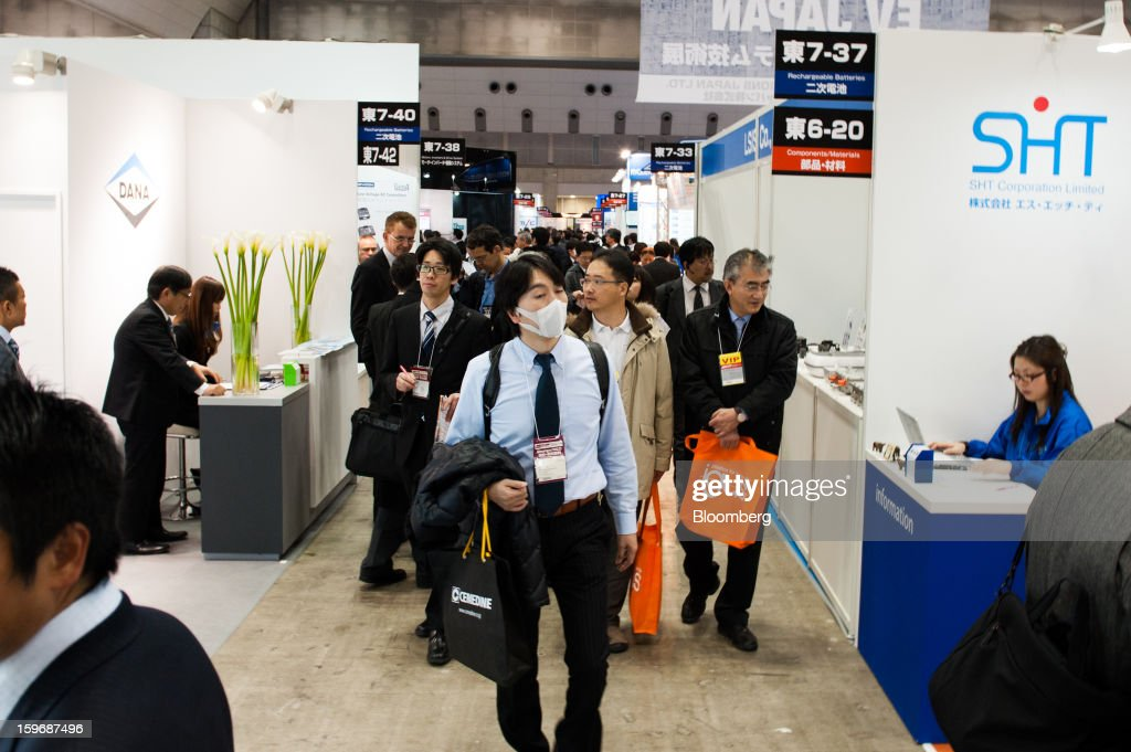 Visitors walk through the Automotive World 2013 trade show in Tokyo, Japan, on Friday, Jan. 18, 2013. The Automotive World 2013 trade show ends today. Photographer: Noriko Hayashi/Bloomberg via Getty Images