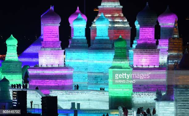 TOPSHOT Visitors walk through the China Ice and Snow World during the Harbin International Ice and Snow Festival in Harbin northeast China's...